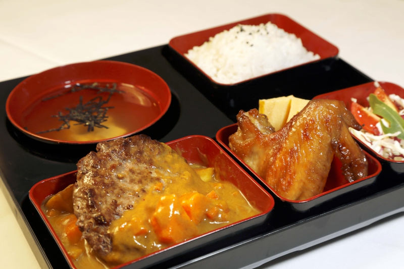 Japan - Beef Burger with Curry Sauce, Teriyaki Chicken Wings, Egg Roll & Cabbage Salad Bento $80