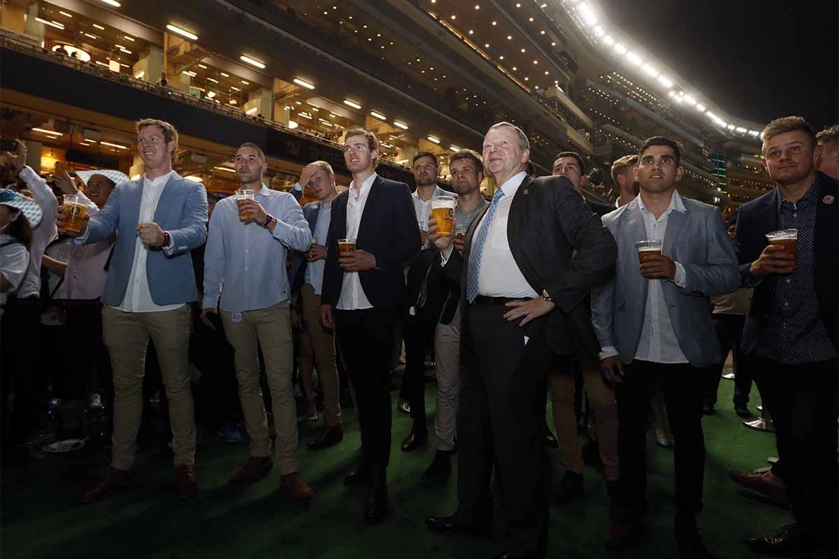 Members of the Richmond Tigers, winners of the Australian Football League Grand Final, enjoy the Oktoberfest party at Happy Valley Racecourse with Mr. Winfried Engelbrecht-Bresges, Chief Executive Officer, The Hong Kong Jockey Club.