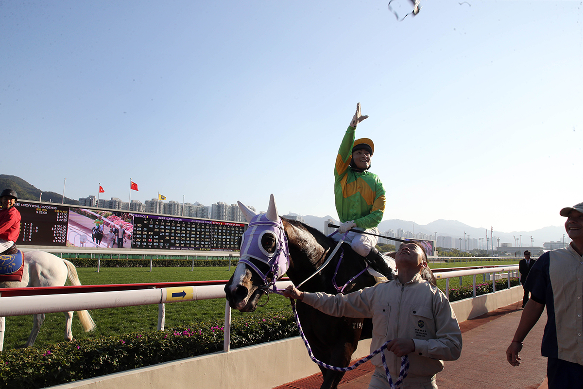 Jockey Keith Yeung throws his goggles to the crowd after winning the Class 2 Hong Kong Shipowners Association 60th Anniversary Cup Handicap on Classic Emperor.