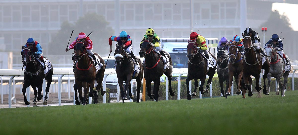 Joao Moreira sends Nothingilikemore (yellow and green) to the lead ahead of a wall of chasers in the Hong Kong Classic Mile today.