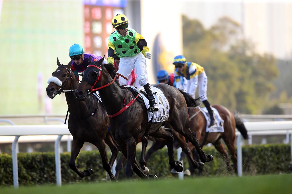 Joao Moreira punches the air as Nothingilikemore wins the Hong Kong Classic Mile, the first leg of the Four-Year-Old Classic Series, from Singapore Sling and Chad Schofield.