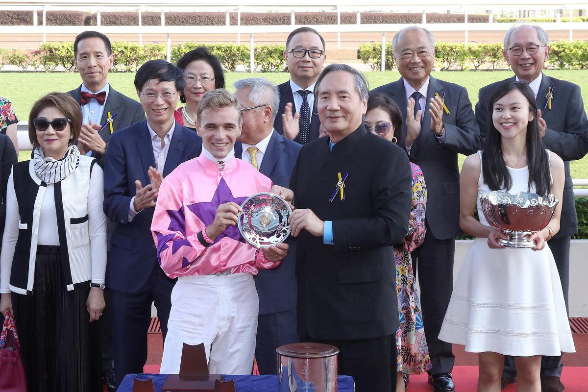 Jockey Sam Clipperton celebrates the biggest success of his Hong Kong career so far.