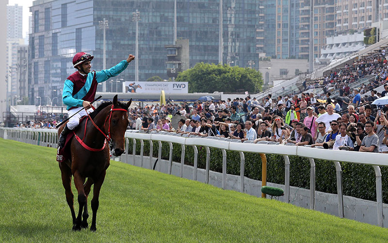 Joao Moreira salutes the crowd after the victory.