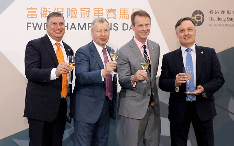 Winfried Engelbrecht-Bresges, CEO of the Hong Kong Jockey Club (2nd left), Andrew Harding, Executive Director, Racing (2nd right); Bill Nader, Director of Racing Business and Operations (1st left); and Nigel Gray, Head of Handicapping, Race Planning and International Racing (1st right), toast a successful FWD Champions Day.
