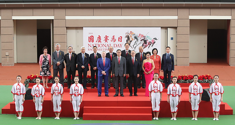 Zhao Jiankai, Deputy Commissioner of the Office of the Commissioner of the Ministry of Foreign Affairs of the People's Republic of China in the HKSAR (front row, second from left), Club Chairman Anthony W K Chow (front row, third from left), Club Stewards and CEO Winfried Engelbrecht-Bresges (front row, first from left), officiate at the opening ceremony of the National Day Race Meeting at Sha Tin Racecourse.