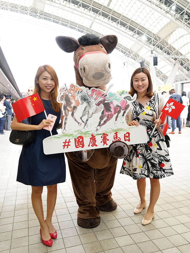 Racegoers enjoy a public holiday meeting on National Day at Sha Tin Racecourse.