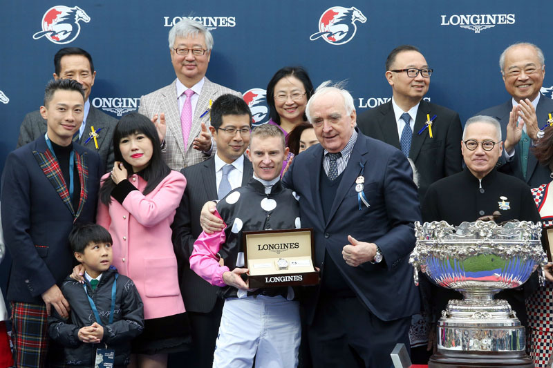 Mr Walter von Känel, President of LONGINES presents a LONGINES Conquest Classic Collection watch to Mrs Eleanor Kwok, owner representative of Beauty Generation, trainer John Moore and jockey Zac Purton.