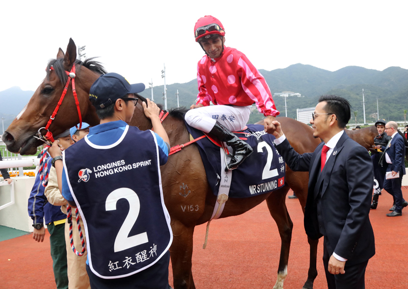 Mr Stunning's jockey Karis Teetan, trainer Frankie Lor, owner's friend and related connections celebrate their success after taking the LONGINES Hong Kong Sprint.