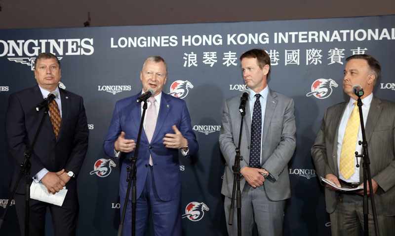 HKJC Chief Executive Officer Mr. Winfried Engelbrecht-Bresges (second from left) hosts the LONGINES Hong Kong International Races post-race press briefing, accompanied by Executive Director, Racing Mr. Andrew Harding (second from right), Director, Racing Business and Operations Mr. William A. Nader (left), and Head of Handicapping, Race Planning and International Racing Mr. Nigel Gray (right).