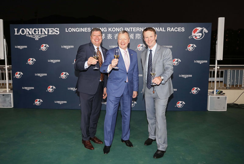 From left: Mr. William A. Nader; Mr. Winfried Engelbrecht-Bresges and Mr. Andrew Harding, toast and celebrate the success of the LONGINES Hong Kong International Races.