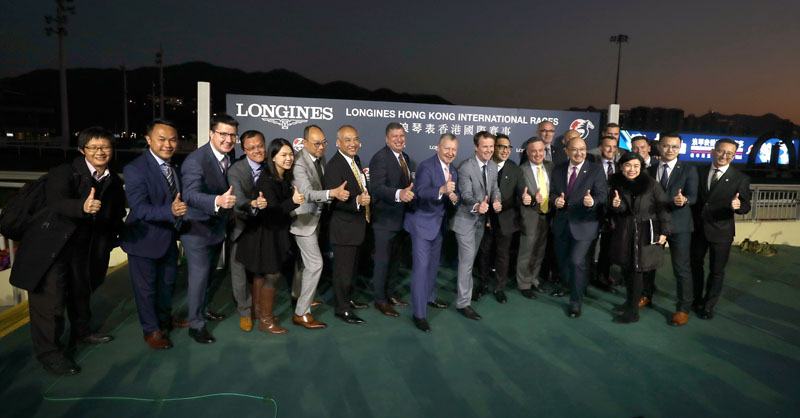 A group photo of HKJC officials and staff after the LONGINES Hong Kong International Races.