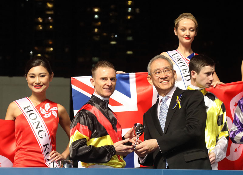 Dr Anthony W K Chow, Chairman of the Club, presents a silver goblet to each of the 12 participating jockeys.