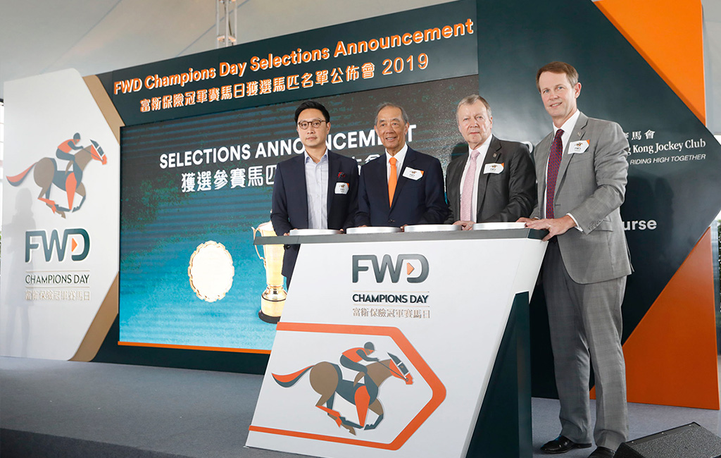 HKJC CEO Winfried Engelbrecht-Bresges (second from right), HKJC Executive Director, Racing Andrew Harding (right), The Hon. Ronald Arculli, Chairman, Board of FWD Group (second from left) and Paul Tse, Chief Marketing Officer, FWD Hong Kong and Macau (left) jointly announce the selected runners for the 2019 FWD Champions Day.