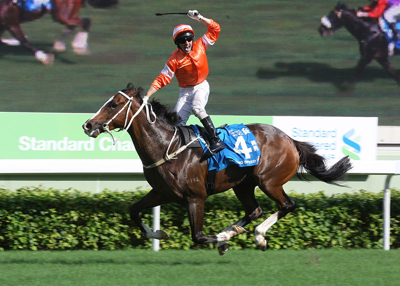 Callan celebrates the win aboard Blazing Speed in the 2014 Standard Chartered Champions & Chater Cup.