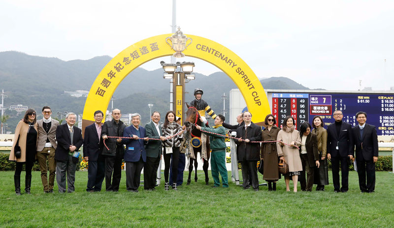 Connections of D B Pin celebrate their success after the race.