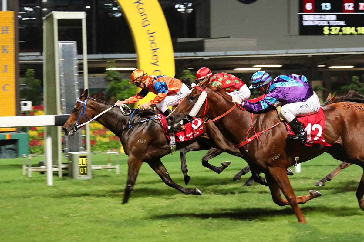 Best Step (orange) holds off the late charge of Charity Glory (purple) to take the Class 3 Wistaria Handicap (1200m), giving jockey Zac Purton a four-timer.
