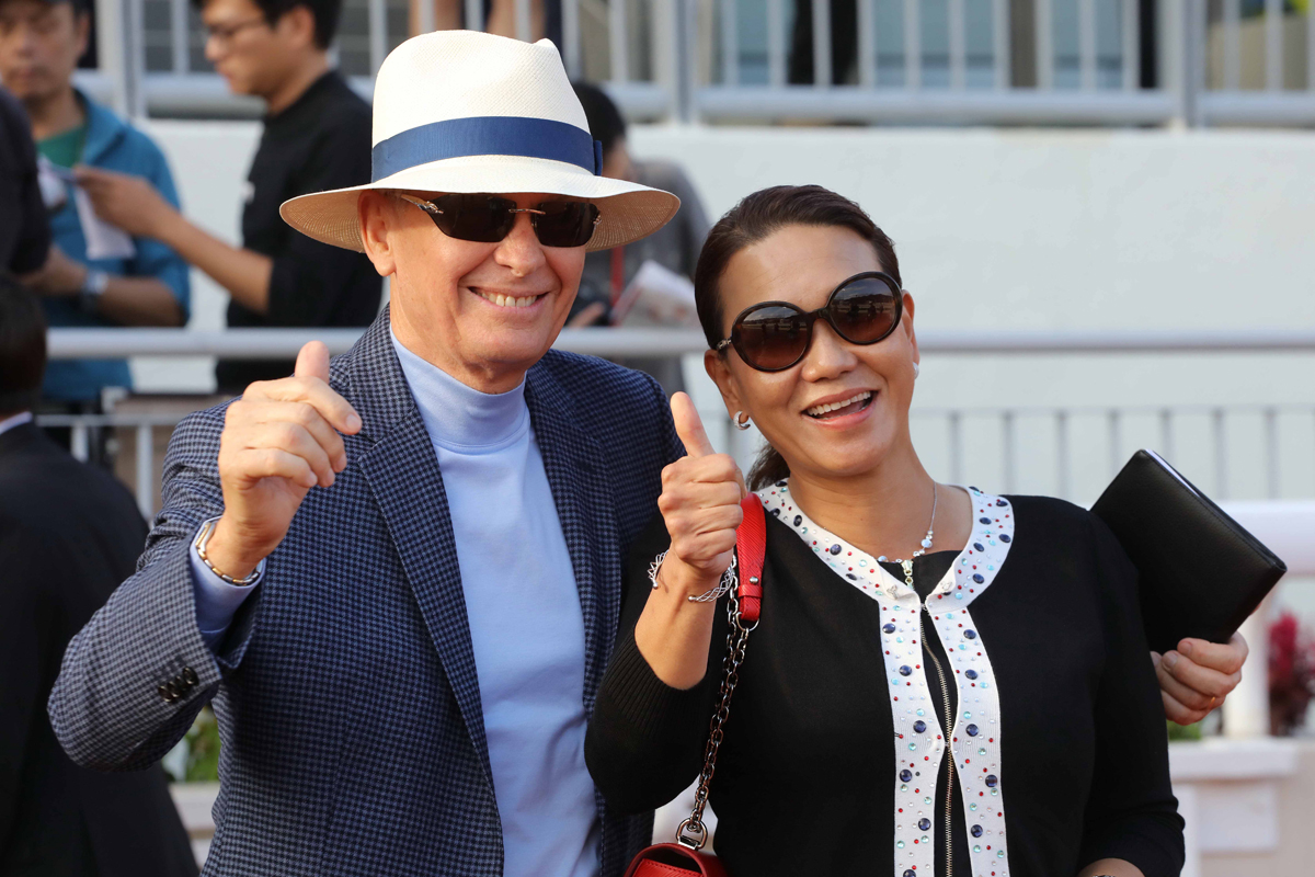 Trainer John Moore and his wife Fifi celebrate Eagle Way's win.