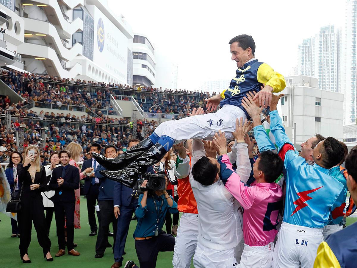 Douglas Whyte is lifted into the air by his fellow jockeys.