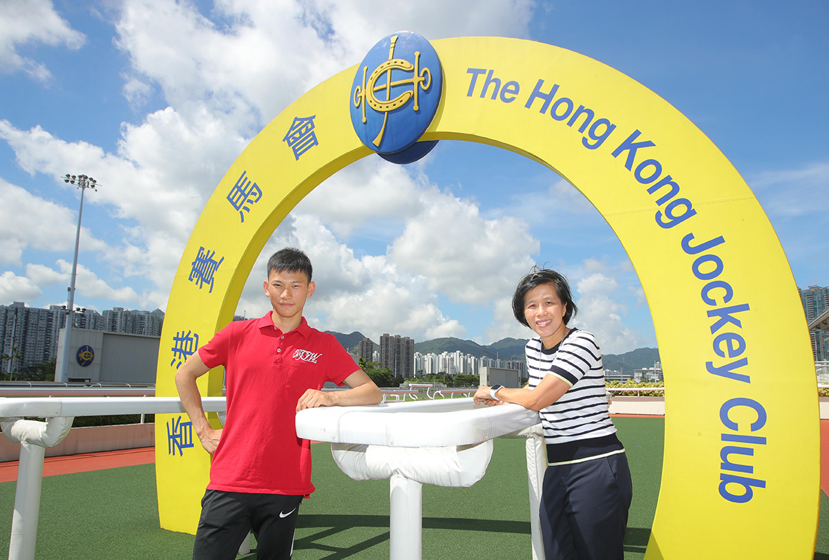 Amy Chan, the Club's Racing Development Board Executive Manager and Headmistress of the Apprentice Jockeys' School, and Apprentice Jockey Jerry Chau.