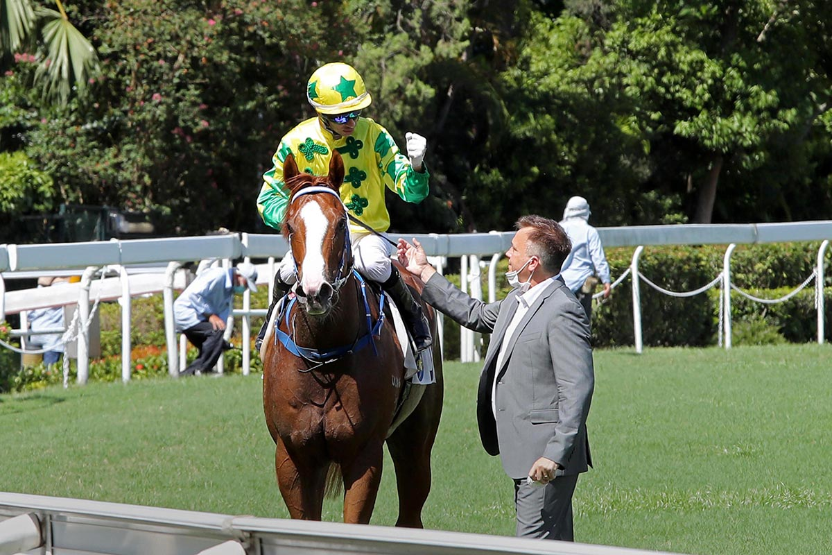 Joao Moreira and Caspar Fownes celebrate an easy win.